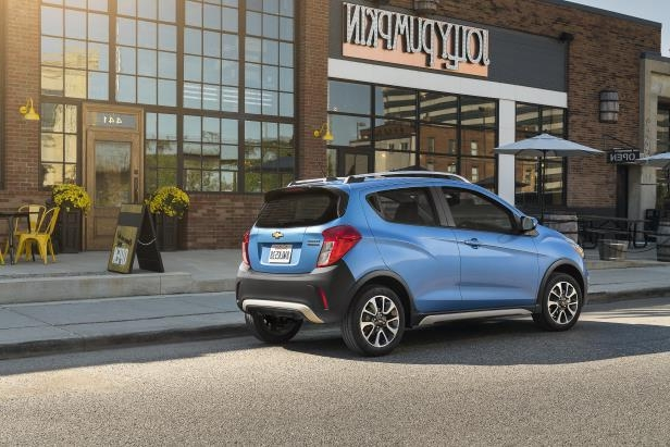 a car parked in front of a building: Buying Used: 2013-2017 Chevrolet Spark