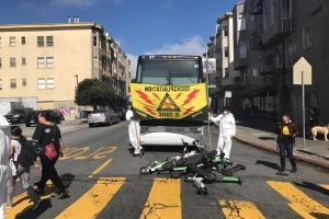 Protesters toss scooters into street to block tech buses in SF