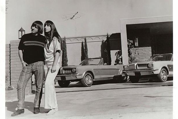 Slide 11 of 26: sonny-cher-ford-mustang-black-white-photo.jpg