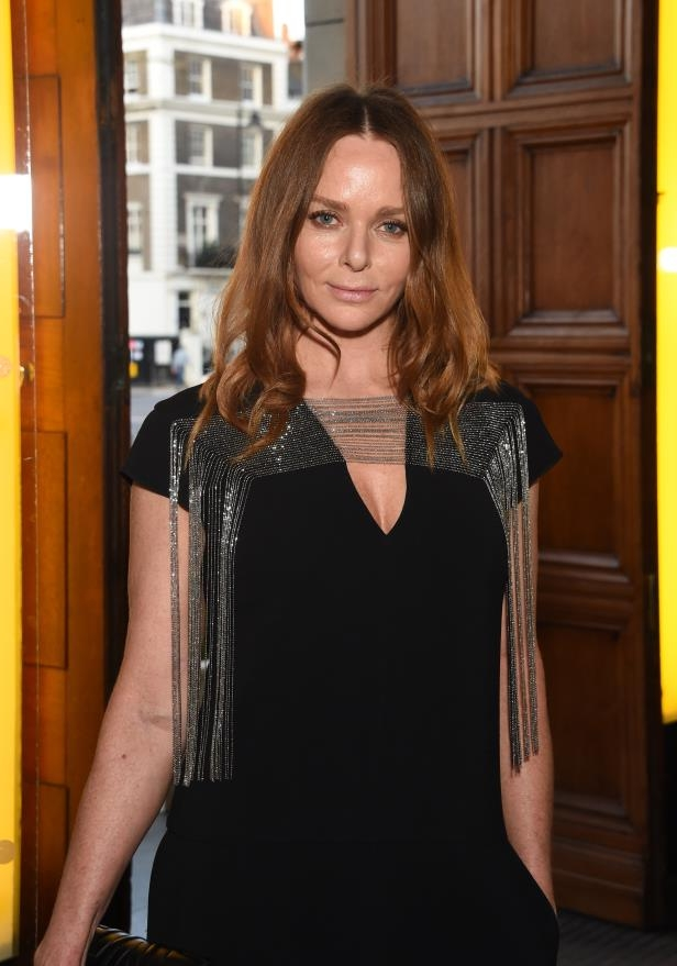 Stella McCartney standing in front of a window