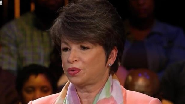 Valerie Jarrett with pink hair looking at the camera