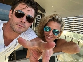 a man wearing sunglasses taking a selfie: Smitten:The 41-year-old stunner was all smiles as she huddled close to Chris, 34, on a balcony