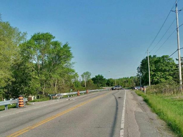 a narrow road: A driver collided with a group of stationary cyclists on this stretch of Bath Road west of Kingston, Ont., on May 27, 2018.
