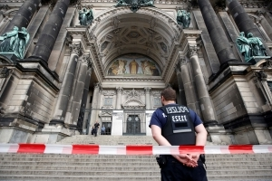 Man with knife, officer wounded in Berlin cathedral shooting