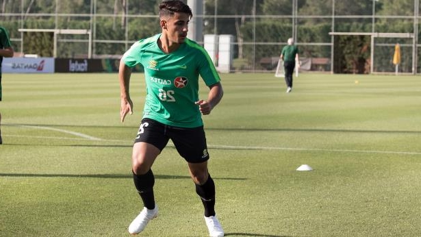 a girl playing football on a field: Teenager Daniel Arzani is set to become the youngest Socceroo to ever play at a World Cup, in just under two weeks' time. Picture: AAP.