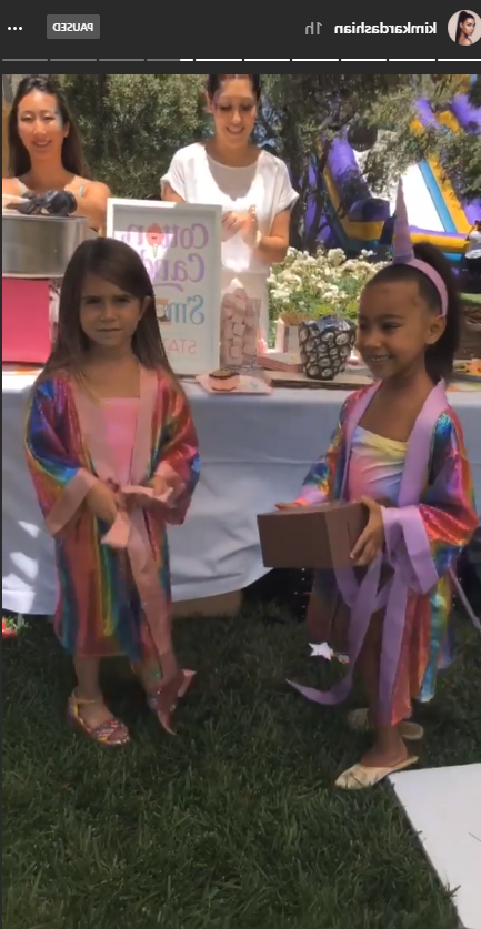 a group of people posing for the camera: North West and Penelope Disick's birthday party.