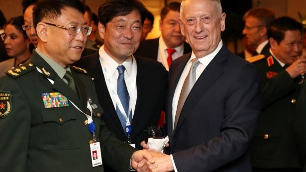 James Mattis, Itsunori Onodera standing next to a man in a suit and tie: Key Speakers At The IISS Shangri-La Dialogue