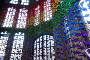 U of T celebrating Pride with rainbow flag made up of 3,000 paper cranes