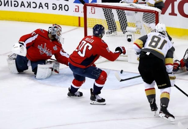 a hockey game in the snow: With Capitals goaltender Braden Holtby out of position, the Knights' James Neal misses the open net in Washington's 6-2 victory in Game 4 on Monday.