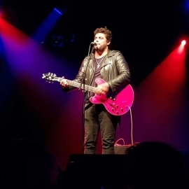 Dan Sultan plays the guitar during a performance in Cairns on June 2. The artist later apologised for 'inexcusable' behaviour, with fans also demanding refunds.