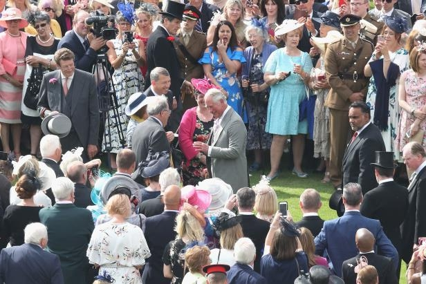 Royal Garden Party: The Prince of Wales speaks to guests at a Royal Garden Party at Buckingham Palace (Chris Jackson/PA)