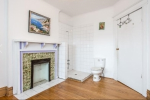 A room with a loo: A Toronto house with a toilet in the living room is selling for $900,000