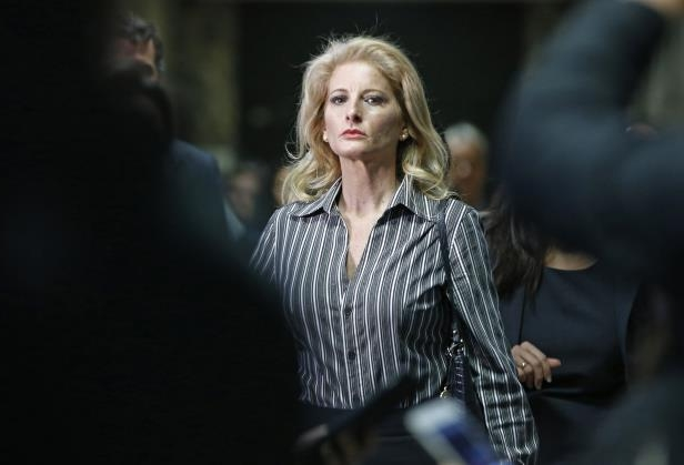 FILE- In this Dec. 5, 2017 file photo, Summer Zervos leaves Manhattan Supreme Court at the conclusion of a hearing in New York. A New York court said Thursday, May 17, 2018, that the former