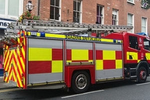 Dublin Fire Brigade post pic of taxi stuck on top of street lamp after collision in city centre