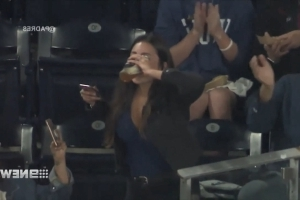 Fan catches foul ball with beer cup