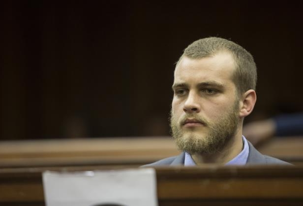 Henri van Breda sits in the dock in the High Court in Cape Town, South Africa, during sentencing. Thursday, June 7, 2018. Van Breda has been sentenced to life in prison for the 2015 ax murders of his parents and brother and received a separate sentence of 15 years for the attempted murder of his sister. (AP Photo/Halden Krog): Henri van Breda sits in the dock in the High Court in Cape Town, South Africa, during sentencing on June 7, 2018.