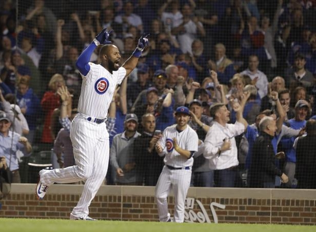 The Cubs' Jason Heyward celebrates his game-winning grand slam off Phillies relief pitcher Adam Morgan.