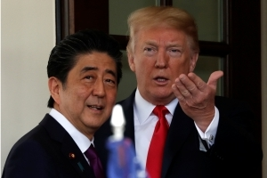 Trump greets Japan's Abe for talks ahead of Kim summit