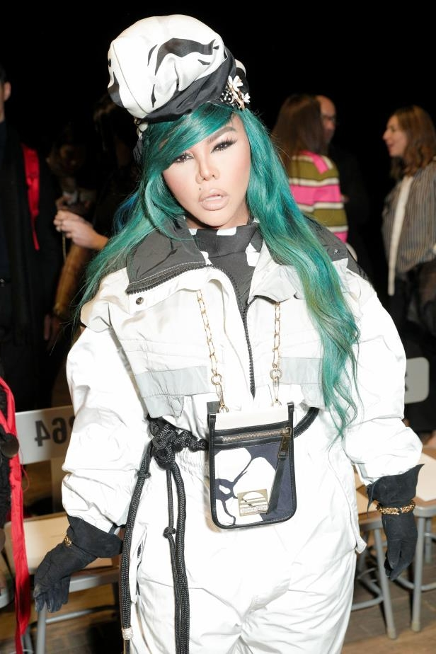 a person wearing a costume: Lil Kim attends the Marc Jacobs show, Fall Winter 2018, during New York Fashion Week on Feb. 14, 2018.