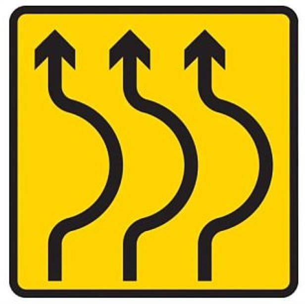 a drawing of a face: Sharp bends ahead where traffic is diverted on to a temporary road for a short distance