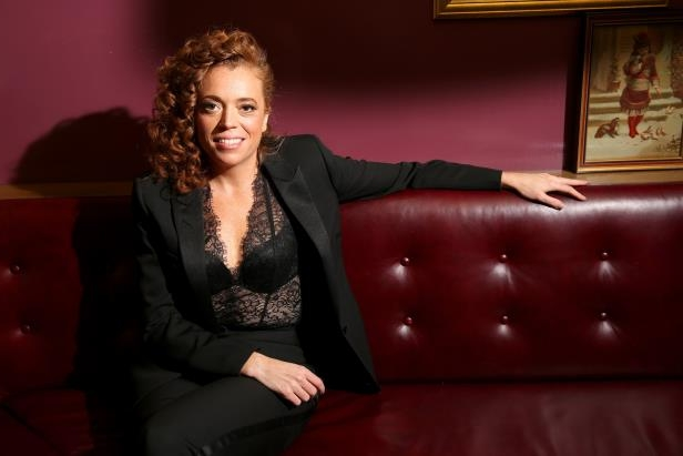 a woman sitting on a leather couch: Michelle Wolf has hit out at Ivanka Trump