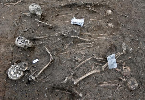 A view shows partial skeleton remains, with skull and bones, from an ancient burial area that was excavated at a building site in Bordeaux