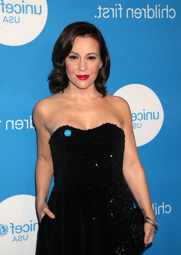 Alyssa Milano holding a sign posing for the camera: Alyssa Milano attends the Unicef Ball in Los Angeles on April 14, 2018.