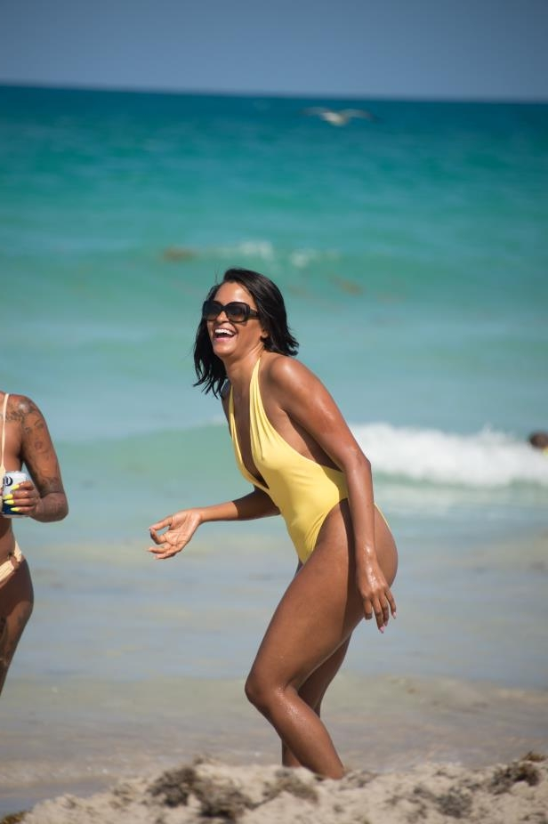 Slide 12 of 67: Claudia Jordan laughed while frolicking on the beach in Miami on April 13.