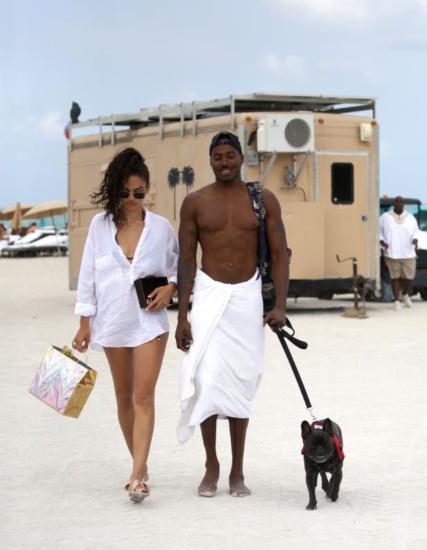 Slide 15 of 67: Shanina Shaik and DJ Ruckus hung with their dog on the beach in Miami on May 1.