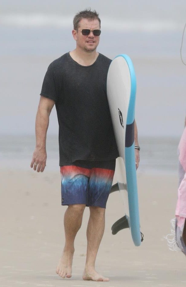 Slide 20 of 67: Matt Damon carried a surfboard on the beach in Sydney on March 29.