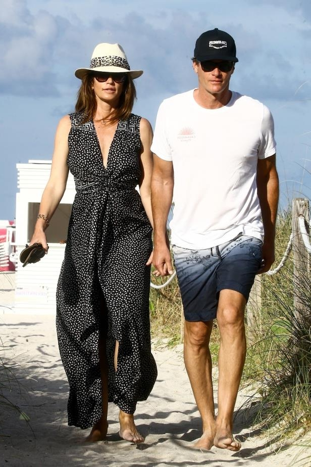 Slide 23 of 67: Cindy Crawford and Rande Gerber held hands during a stroll on the beach while vacationing in Miami on March 31.