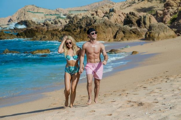 Slide 24 of 67: Sasha Farber and Emma Slater strolled on the beach during their honeymoon at the Grand Fiesta Americana Los Cabos resort in Mexico on April 8.