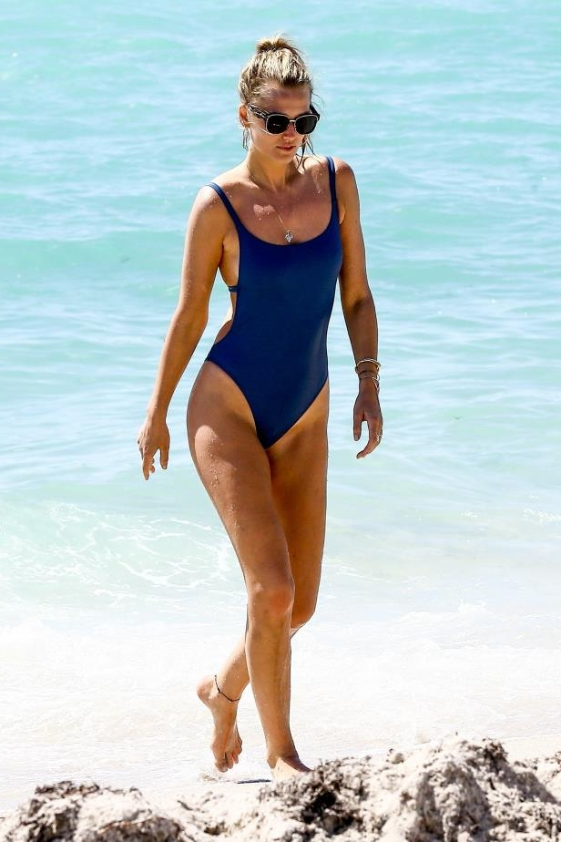 Slide 28 of 67: Model Toni Garrn strolled the beach in Miami on April 2.