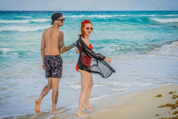 Slide 29 of 67: Madelaine Petsch and boyfriend Travis Mills strolled on the beach at the Live Aqua Beach Resort Cancun in Mexico on April 13.