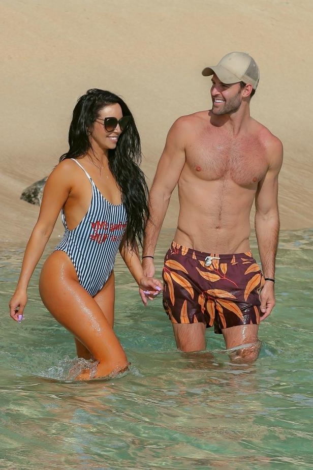 Slide 3 of 67: Scheana Shay and Robby Hayes walk the beach on the North Shore of Oahu on May 23, 2018.