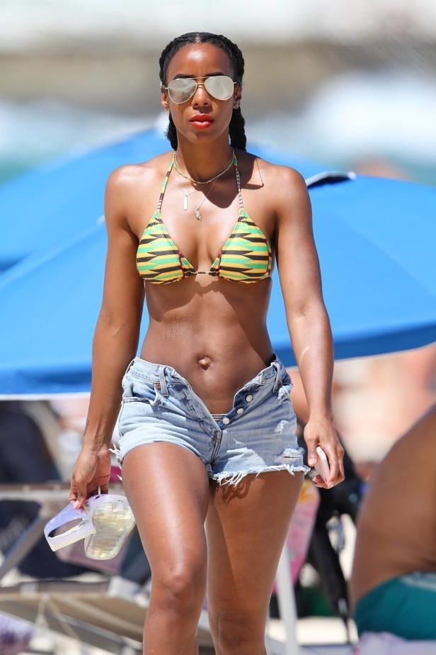Slide 34 of 67: Kelly Rowland wore a yellow-and-green string bikini and cutoffs as she walked along Bondi Beach in Sydney on March 1.