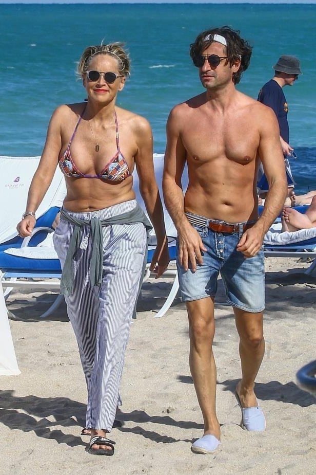 Slide 36 of 67: Sharon Stone looked incredibly youthful in a string bikini while on the beach with boyfriend Angelo Boffa in Miami on March 9.