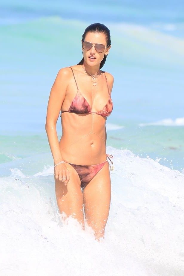Slide 41 of 67: Alessandra Ambrosio was all smiles as she showed off her svelte figure on the beach in Cancun, Mexico, on Feb. 18.