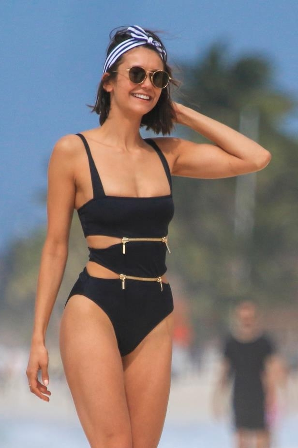 Slide 42 of 67: Nina Dobrev showed off her flawless physique in a zippered swimsuit on the beach in Tulum, Mexico, on Jan. 20.