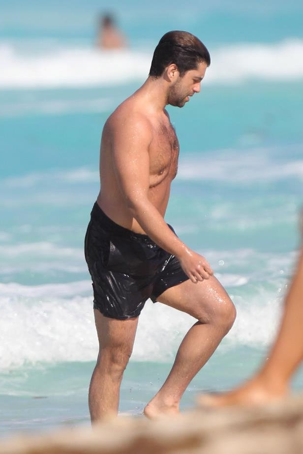 Slide 44 of 67: Josh Peck shows off his weight loss on the beach in Cancun, Mexico, on Feb. 26