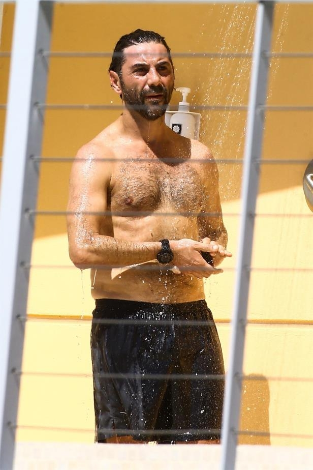 Slide 53 of 67: Eva Longoria's husband, Jose Baston, was spotted showering off after hanging poolside in Miami on Feb. 17.