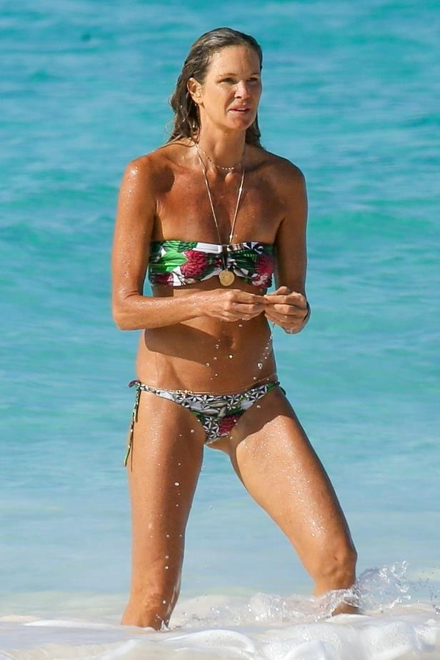 Slide 55 of 67: Elle Macpherson enjoyed a beach break during her New Year holiday in the Bahamas on Jan. 3.
