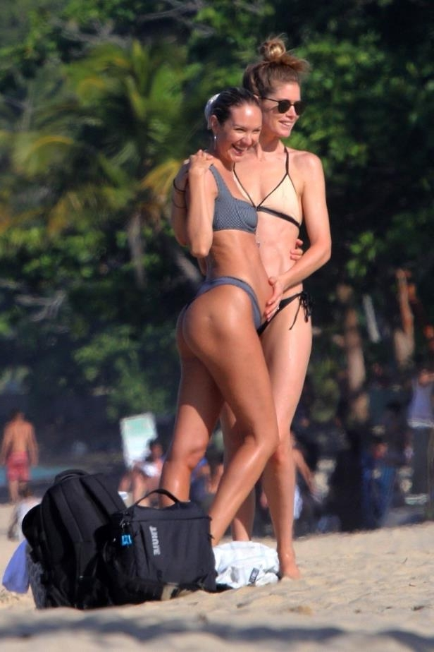 Slide 57 of 67: Victoria's Secret models Candice Swanepoel (she's pregnant!) and Doutzen Kroes hit the beach at Espelho Beach in Brazil on Jan. 5.