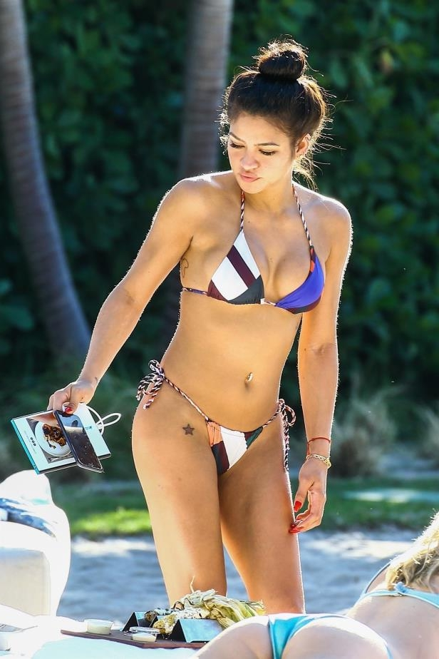 Slide 61 of 67: Cassie flaunted her toned bikini body while hanging poolside at her hotel in Miami on Jan. 2.
