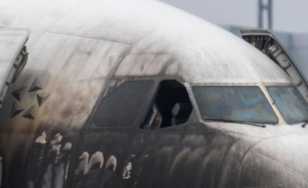 The blackened and heavily damaged cockpit area of Lufthansa Airbus A340 is seen after the incident at Germany's Frankfurt Airport on June 11, 2018. The aircraft was painted in a special Star Alliance paint scheme.