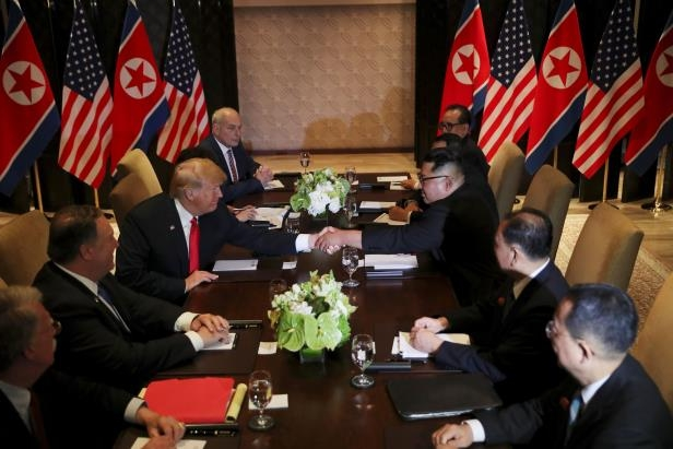 U.S. President Donald Trump shakes hands with North Korea's leader Kim Jong Un before their expanded bilateral meeting at the Capella Hotel on Sentosa island in Singapore June 12, 2018. REUTERS/Jonathan Ernst