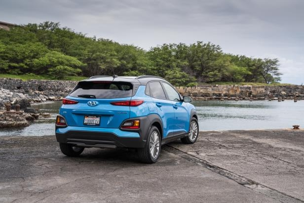 a car parked on the side of a dirt road: 2018 Hyundai Kona Rear