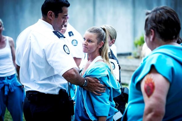 a couple of people that are talking to each other: Will (Robbie Magasiva) tries to keep Kaz in line.