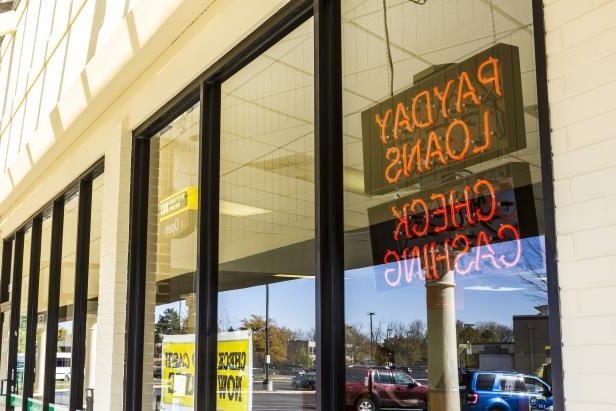 a sign above a store: Rick Moseley Sr., one of a few Kansas City payday lenders whose usurious business practices came under scrutiny by federal investigators, was sentenced on June 12, 2018, by a federal judge in New York to 10 years in prison.