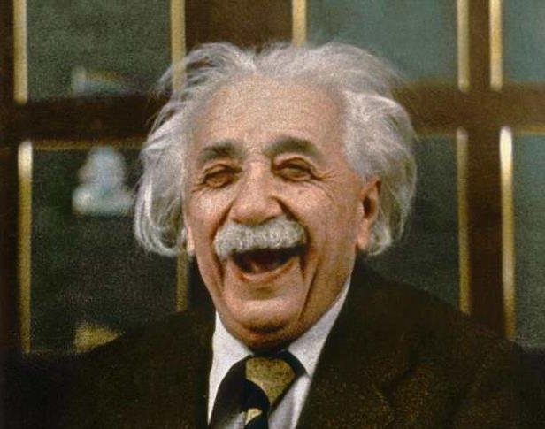 Albert Einstein wearing a suit and tie smiling at the camera: Although her score is higher than Einstein's, there is a caveat; adults can only score a maximum of 161 while children can get 162